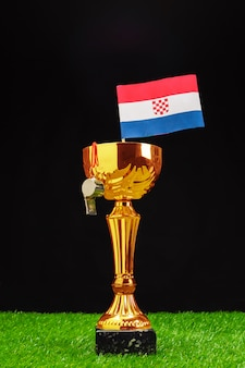 Golden trophy with croatian flag and whistle