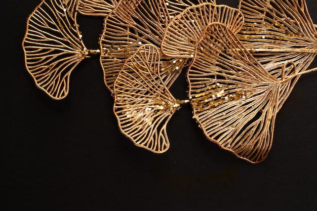 Golden tropical flowers on black background, art deco style bakground