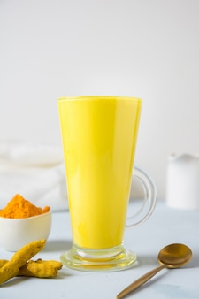 Golden turmeric latte milk with curcuma root