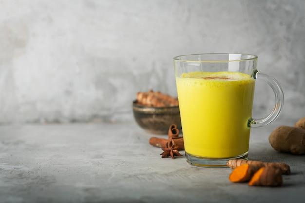 Golden turmeric milk with ingredients