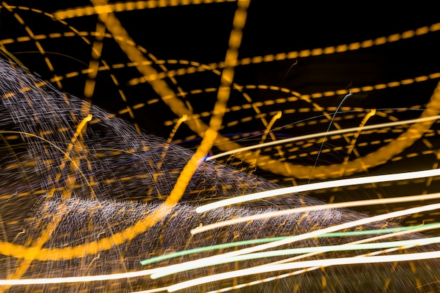 Golden twirling lines on dark backdrop