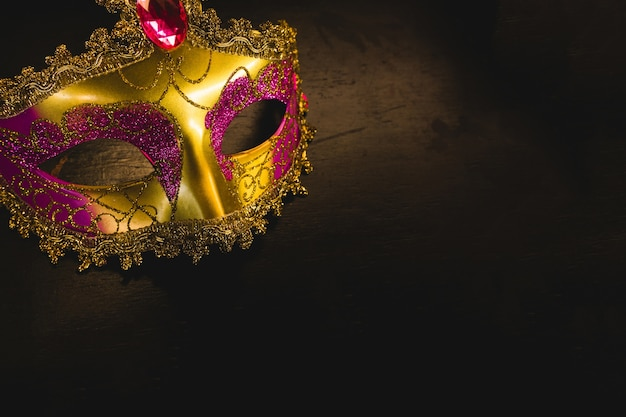 Golden venetian mask on a dark background
