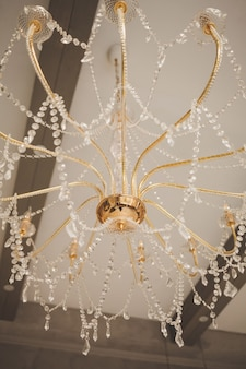 Golden vintage chandelier with crystal decoration