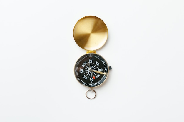 Golden vintage compass isolated on white