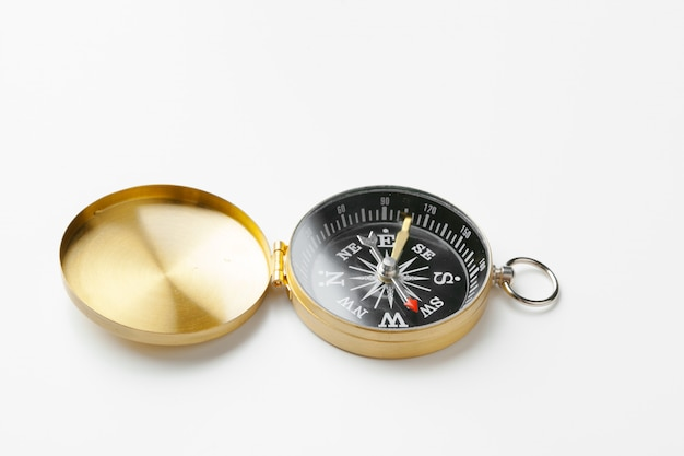 Golden vintage compass isolated