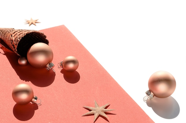 Golden waffle ice cream cone with christmas metallic pink baubles