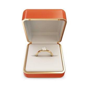 Golden wedding ring with diamond in a box