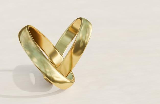 白い背景の上の黄金の結婚指輪