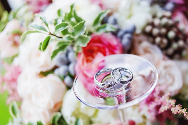 Golden wedding rings with diamonds on glass