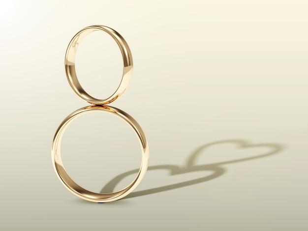 ハートの形をした影のある黄金の結婚指輪