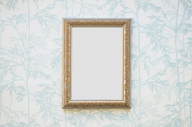 Golden white picture frame on wallpaper