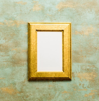 Golden wooden frame isolated on oxidized background