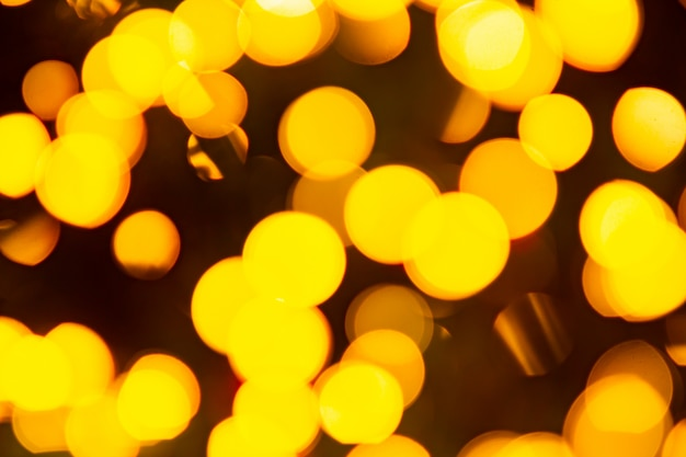 Golden yellow abstract background with bokeh defocused blurred lights