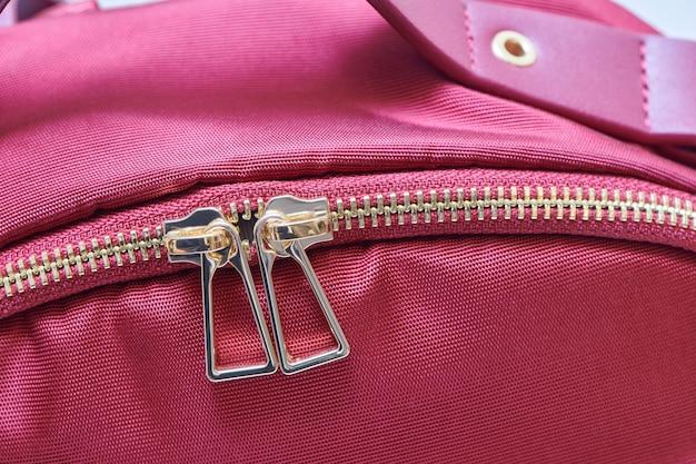 Golden zipper close up view. buttoned metal zipper on bag.