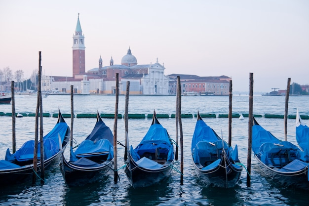 Goldola boat parking in lagoo of grand canal venice italy