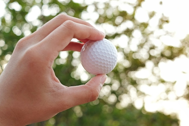 Golf ball on hand blur abstract background