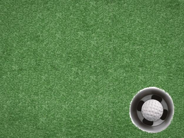 Мяч для гольфа в чашке для гольфа на зеленом виде сверху