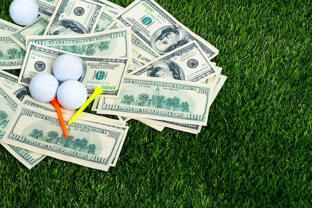 Golf ball and tee on bill bet