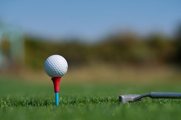 Golf balls on artificial grass with blur background