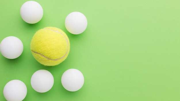 Golf balls and tennis ball with copy-space