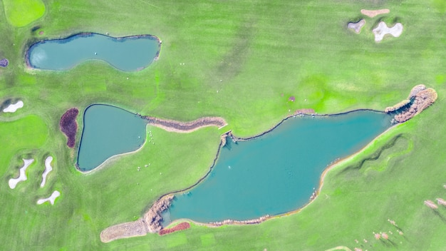 Golf course with high quality lawn and lakes. mezhigorye national park. view from the drone.