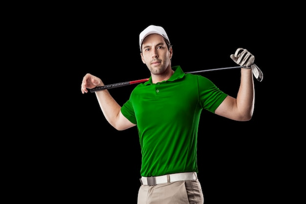 Golf player in a green shirt, on a black background.
