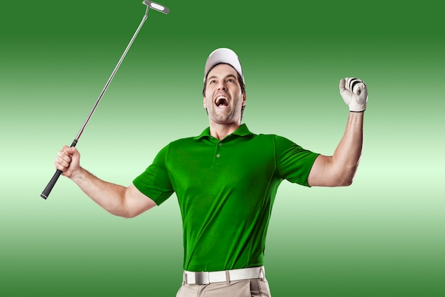 Golf player in a green shirt celebrating, on a green background.