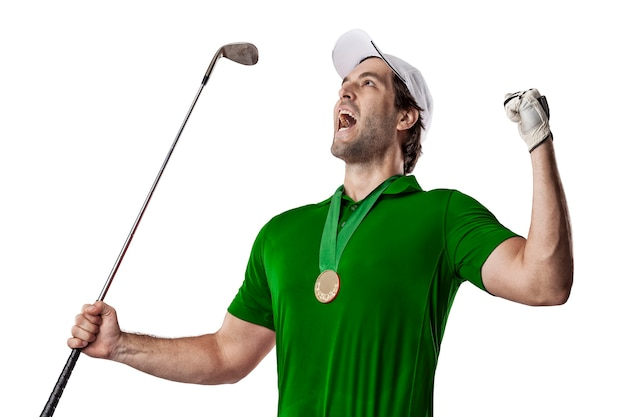 Golf player in a green shirt celebrating with a golden medal, on a white background.