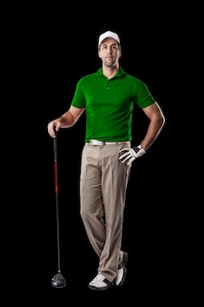 Golf player in a green shirt standing on a black background.