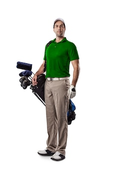 Golf player in a green shirt, standing with a bag of golf clubs on his back, on a white background.