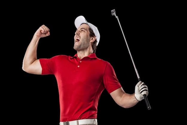 Golf player in a red shirt celebrating, on a black background.