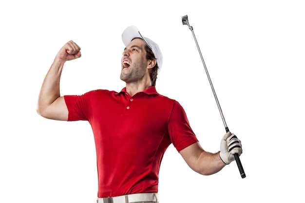 Golf player in a red shirt celebrating, on a white space.