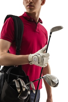 Golf player in a red shirt taking a swing on white studio
