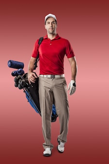 Golf player in a red shirt walking with a bag of golf clubs on his back, on a red background.