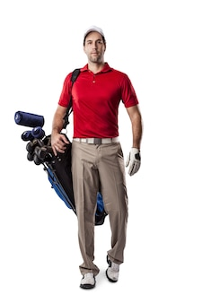 Golf player in a red shirt walking with a bag of golf clubs on his back, on a white space.