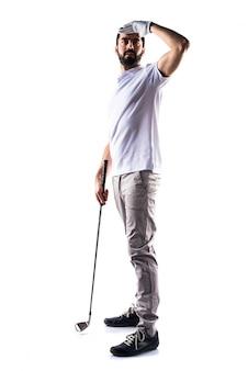 何かを示すゴルファーの男