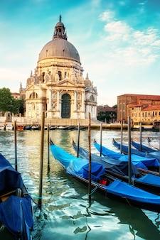 Gondolas and basilica santa maria della salute in venice