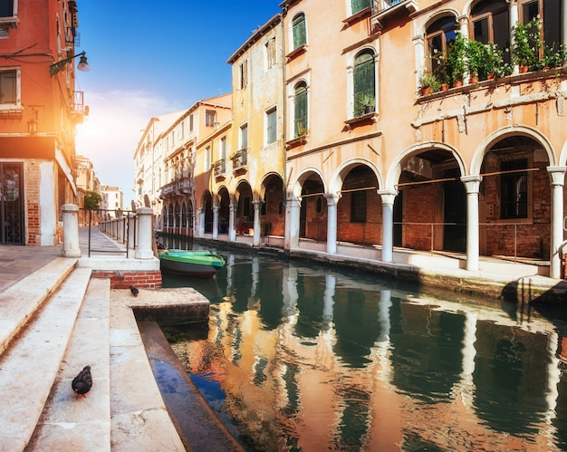 Gondolas on canal in venice. venice is a popular tourist destination