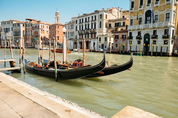 Gondolas on grand canal, tourist people travel around venice in italy