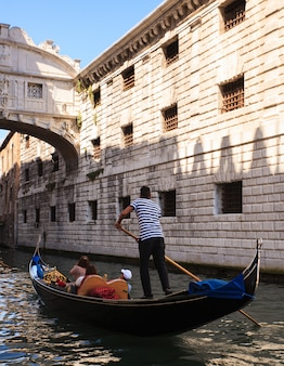 Gondolier under the bridge of sighs in venice