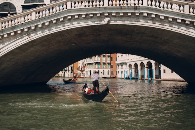Gondolier at the rialto bridge, venice, italy