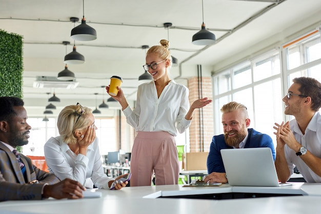 Good-looking pleasant female boss executive discuss business ideas with employees