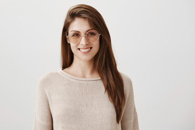 Good-looking young woman in sunglasses smiling