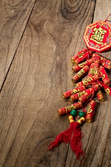 Good luck firecrackers chinese new year or lunar new year 2021 decoration on wooden table