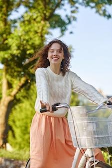 Good mood. a cute fgirl on a bike feeling good and smiling