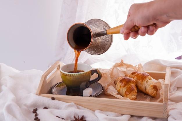 Good morning black coffee with crispy croissants