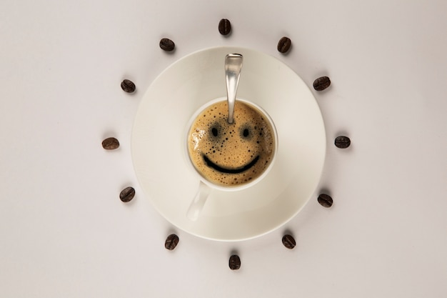 Good morning coffee smile cup on wooden table