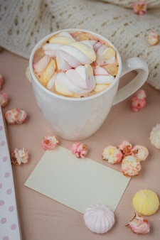 Good morning with hot chocolate on wooden table