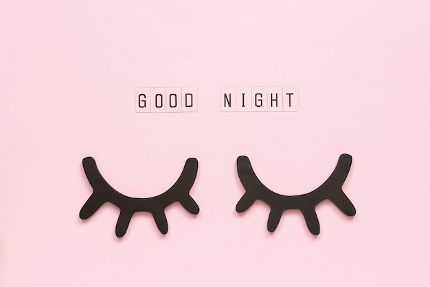 Good night, decorative black eyelashes, closed eyes concept sweet dreams