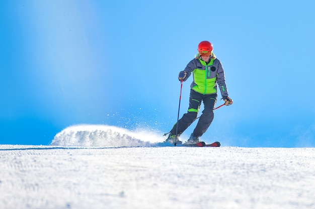 A good skier in action moves the dusty snow to the track